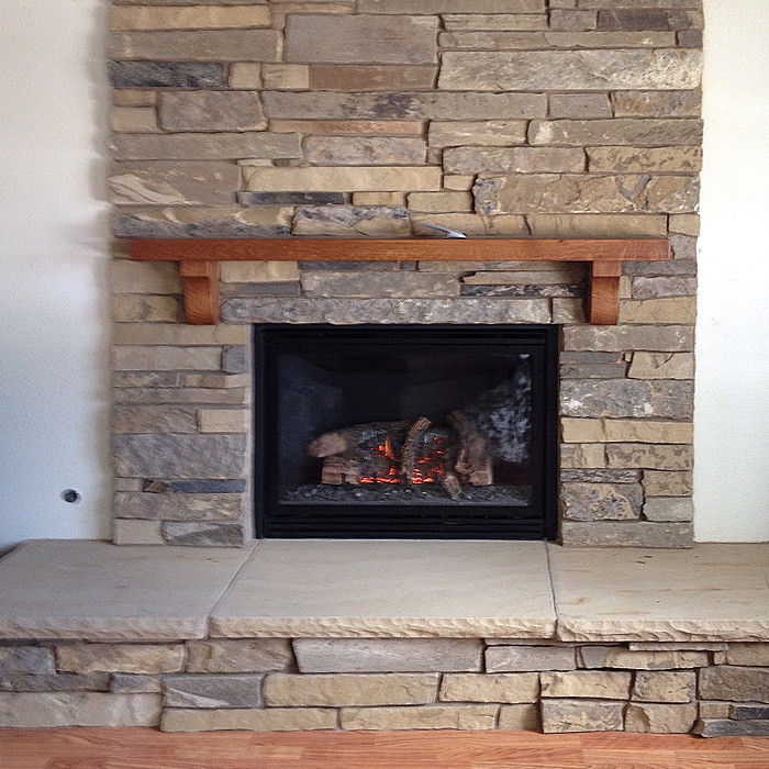 Boulder County CO Custom Fireplace Install with stone surround