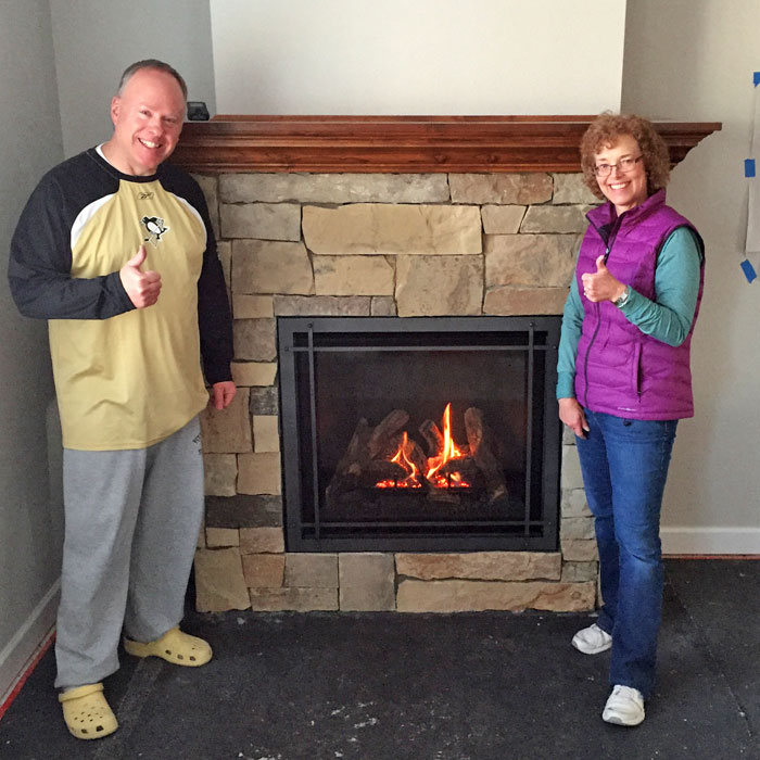 professionals with a newly installed fireplace in Westminster CO