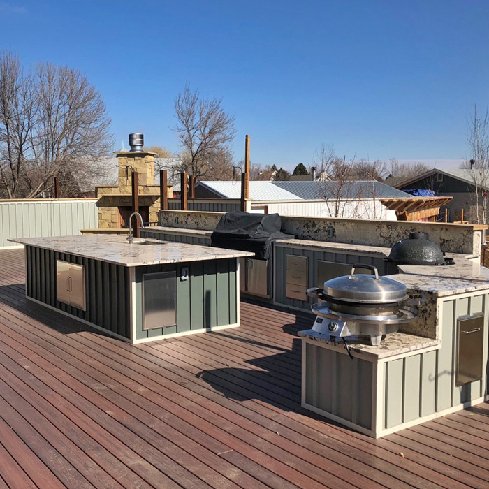 deck with outdoor kitchen and grill in Berthoud CO