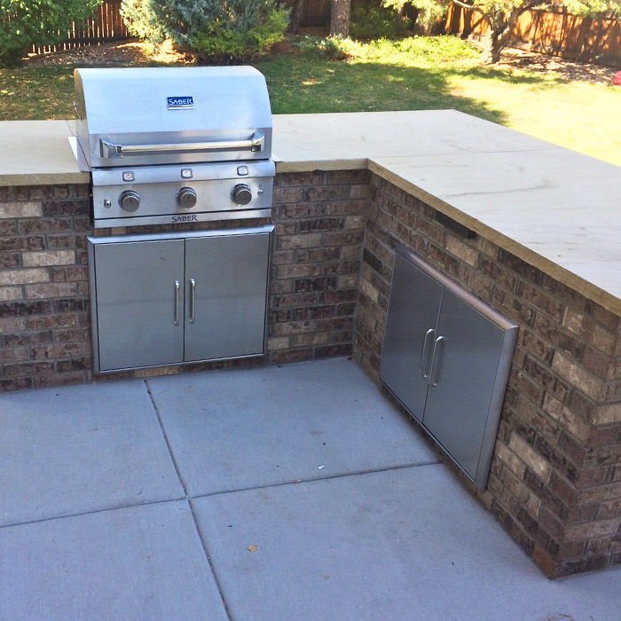 Outdoor kitchen with built-in gas grill in Boulder CO