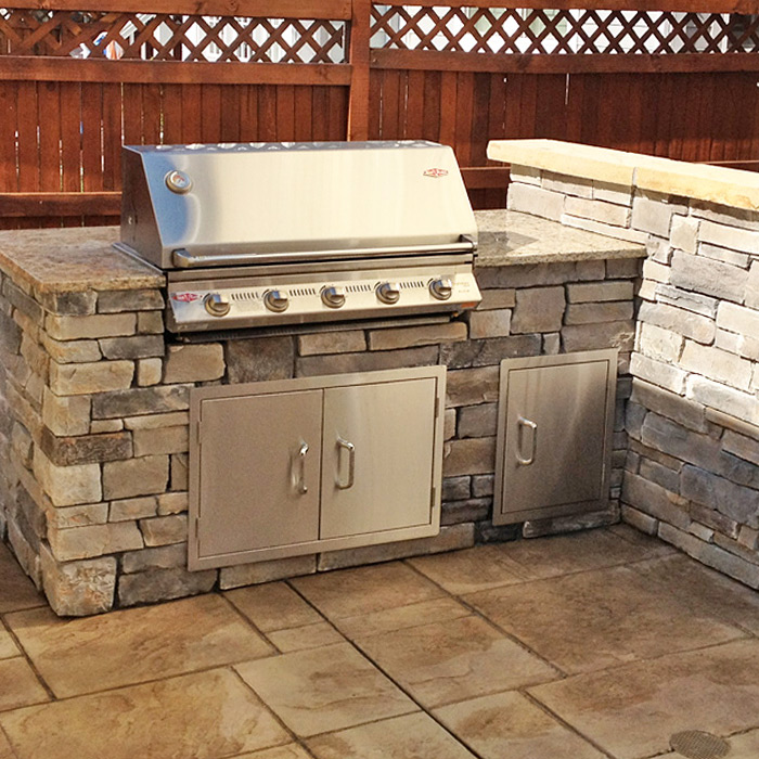Built-in gas grill with outdoor kitchen in Loveland CO