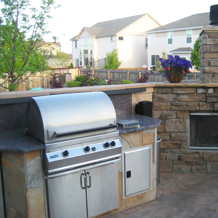 install of new built-in gas grill, outdoor fireplace and outdoor kitchen in Ft Collins Colorado