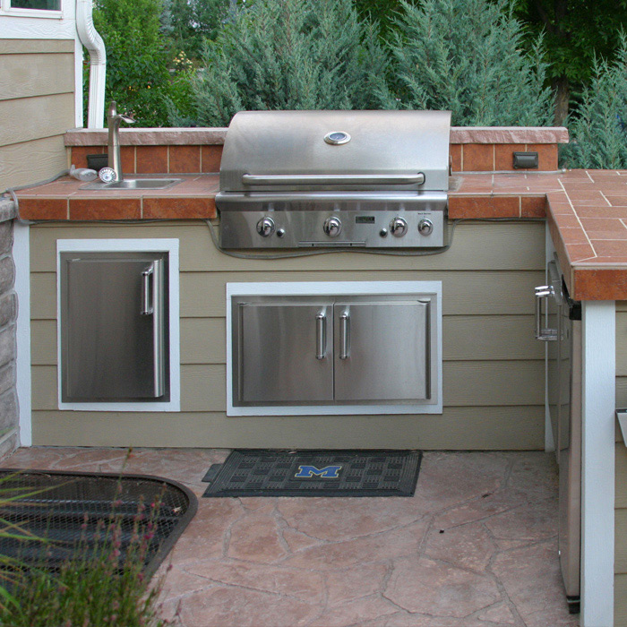 Fort Collins install outdoor kitchen with gas grill and fire pit