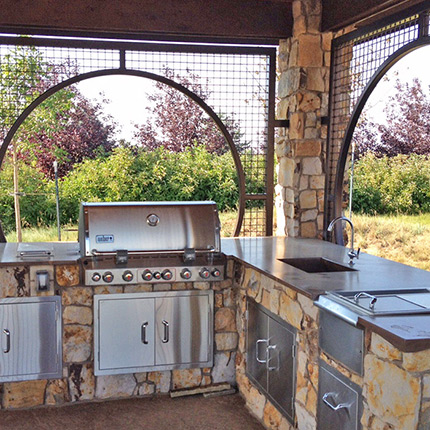 Outdoor Kitchen built in Estes Park CO with sink, dishwasher, refrigerator and gas grill